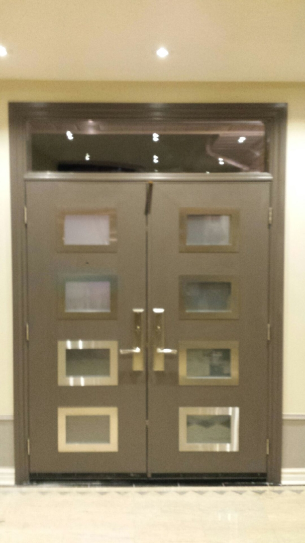 Modern Exterior Door with 8 door lites and stainless steel frams with Transom installed in Kong City- Ontario by modern-doors.ca