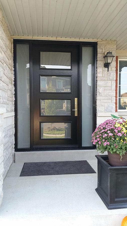 Modern Exterior Door with Multi Point Locks-4 Door lites and 2 Frosetd Side Lites installed in Toronto By Modern Doors