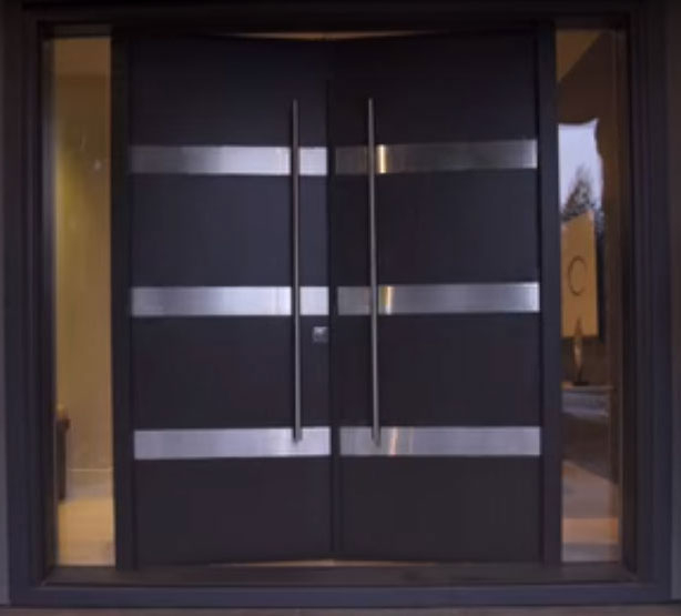 Modern Exterior Door with Stailess Steel lines and multi point locks with 2 side liites installed in modern home