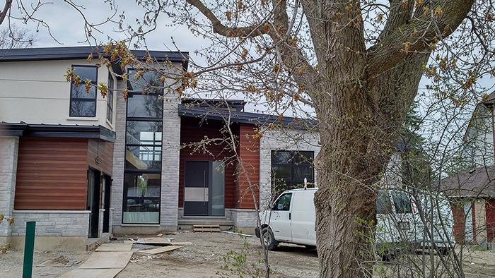 Modern Exterior Door with Stainless Steel bar Installed in Modern House in Bathurst