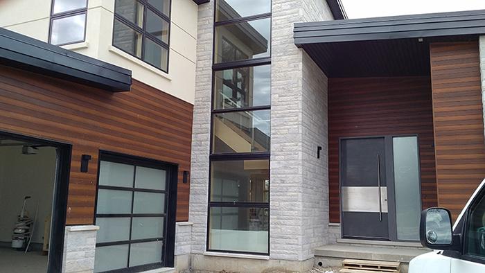 Modern Exterior Door with Stainless Steel bar Installed in Modern-House in Bathurst