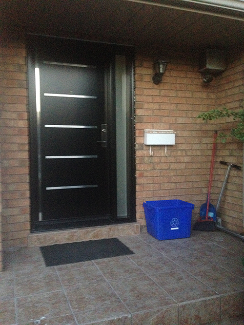 Modern Fiberglass Doors with Stainless Steel 5 strips and frosetd side lite installed in Richmond Hill by Modern Doors