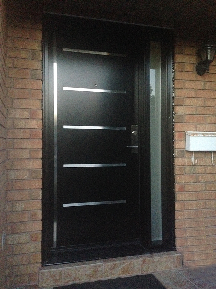 Modern Fiberglass Doors with Stainless Steel strips and frosetd side lite installed in Richmond Hill by Modern Doors