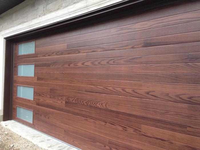 Modern Fiberglass Garage Doors-Fiberglass Woodgrain Modern Garage door with frosted door lites manufactured and installed by modern-doors
