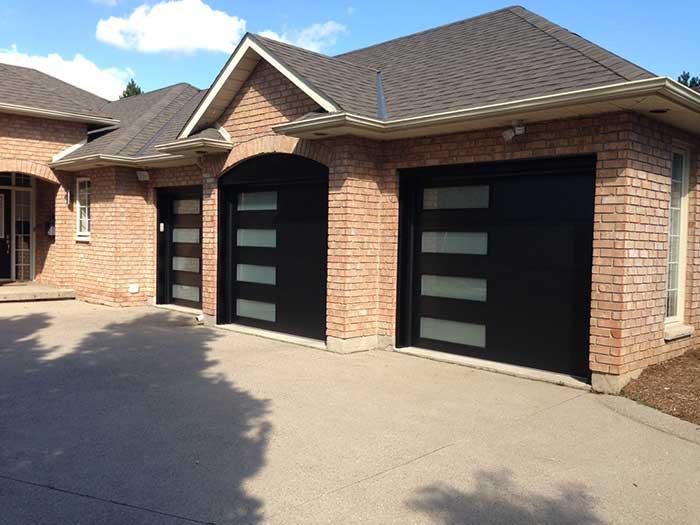Modern Fiberglass Garage Doors with Frosted Side lites installed in Oakville by Modern Doors