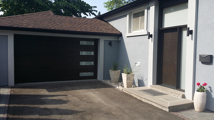 Modern Fiberglass Garage Woodgrain Door with Frosted Door Lite installed by Modern Doors