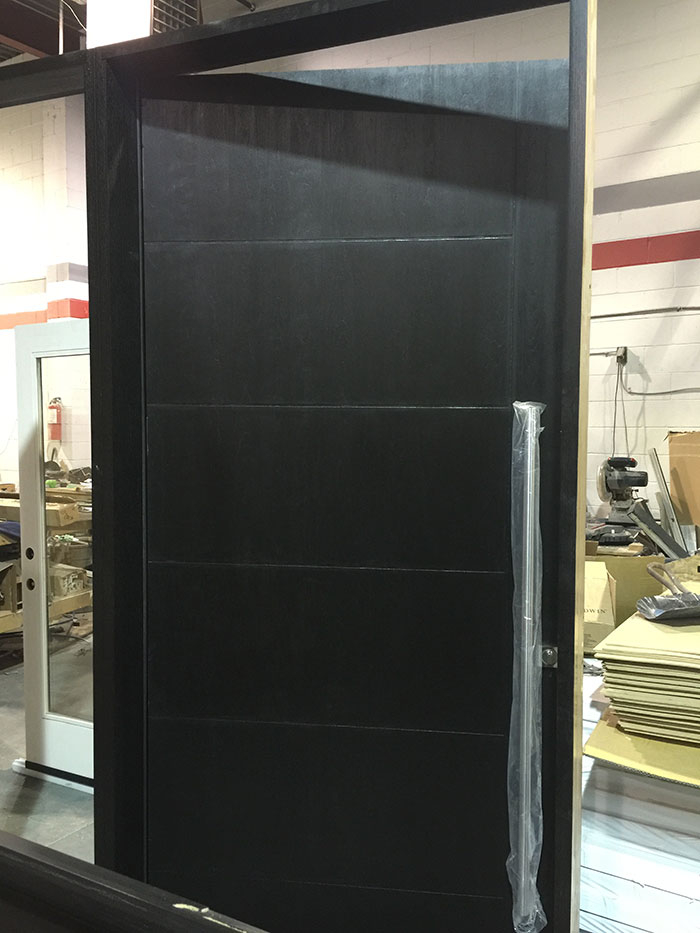 Modern Fiberglass Rustic Door WIth Stainless Steel Bar and a side lite-During Manufacturing by Modern Doors
