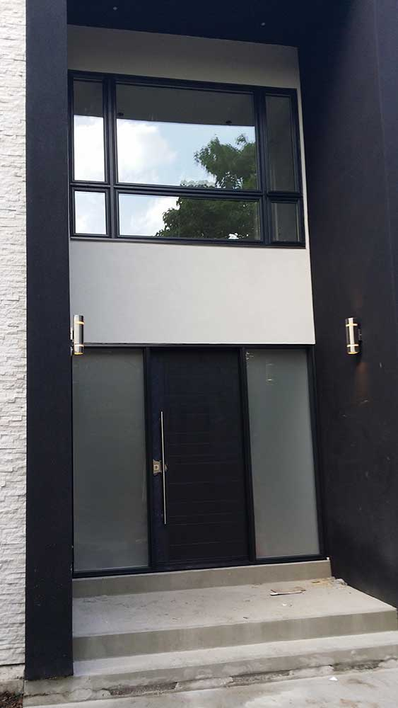 Modern Fiberglass Rustic Door with 2 frosted sidelites installed in Thornhill