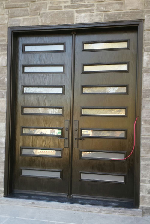 Modern Fiberglass Woodgrain Double Doors with Clear Door Lites and Multipoint Locks installed in Modern House