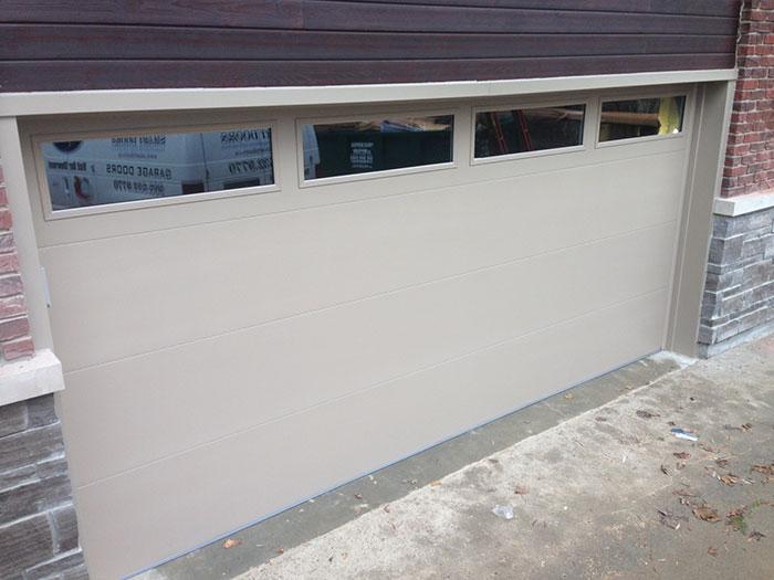 Modern Garage Door Beige Color with Clear Glass Door Lites Installed in Richmond Hill