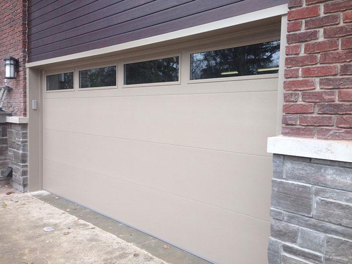 Modern Garage Door-Double Gargae Door Beige Color with Clear Glass Door Lites Installed in Richmond Hill