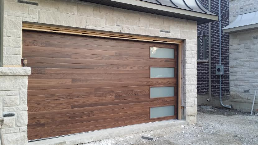 Modern Garage Door- Fiberglass Wood Grain Modern Door with 4 Frosted Lite installed in Thornhill by modern-doors.ca