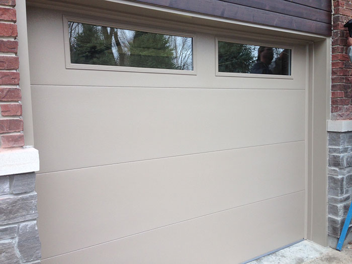 Modern Garage Door-Single Garage Door Beige Color with Clear Glass Door Lites Installed in Richmond Hill