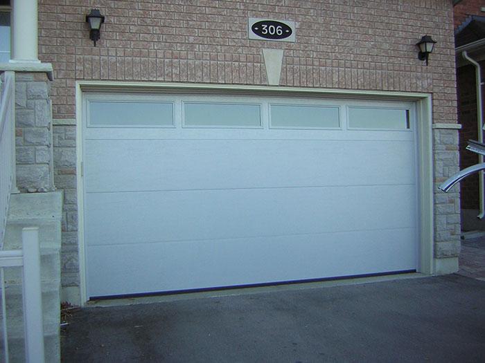 Modern Garage Doors-Fiberglass Modern Garage Door with 4 lites installed in Woodbridge by modern-doors.ca