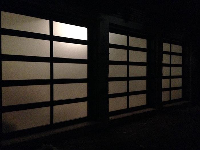 Modern Garage Doors-Modern Aluminum Garage Doors with Frosted Door Lites installed in a new modern home in Richmond Hill