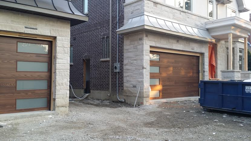 Modern Garage Doors installed in Thornhill- Fiberglass  Wood Grain Modern Door with 4 Frosted Lite installed in Thornhill by modern-doors.ca