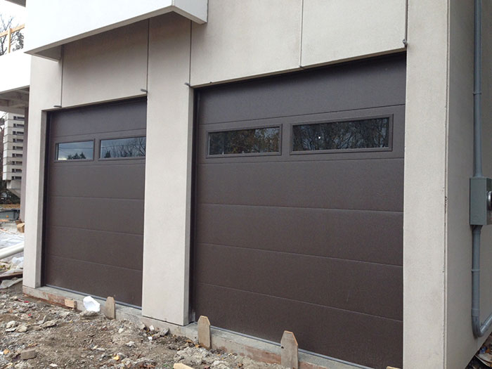 Modern Garage Doors with 2 clear Door Lites-Fiberglass Garage Doors installed in Modern House by modern-doors