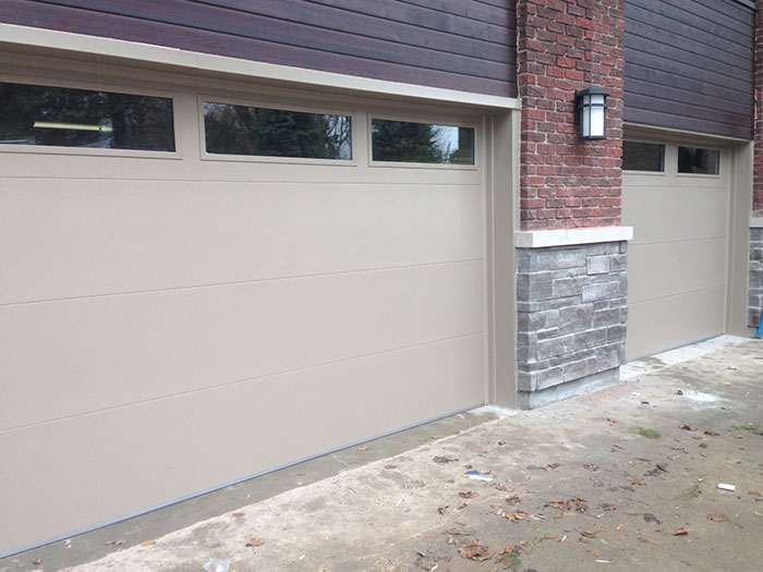 Modern Garage Doors with Clear Glass Door Lites Installed in Richmond Hill