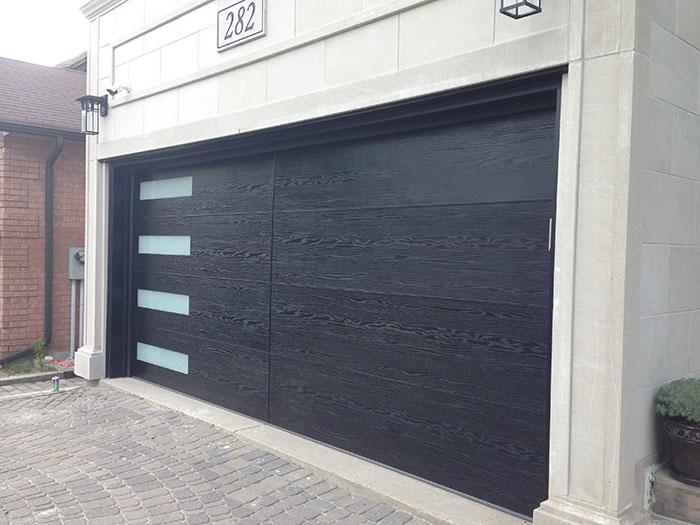 Modern Garage Woodgrain Fiberglass Door with Door Lite Installed in Richmond Hill