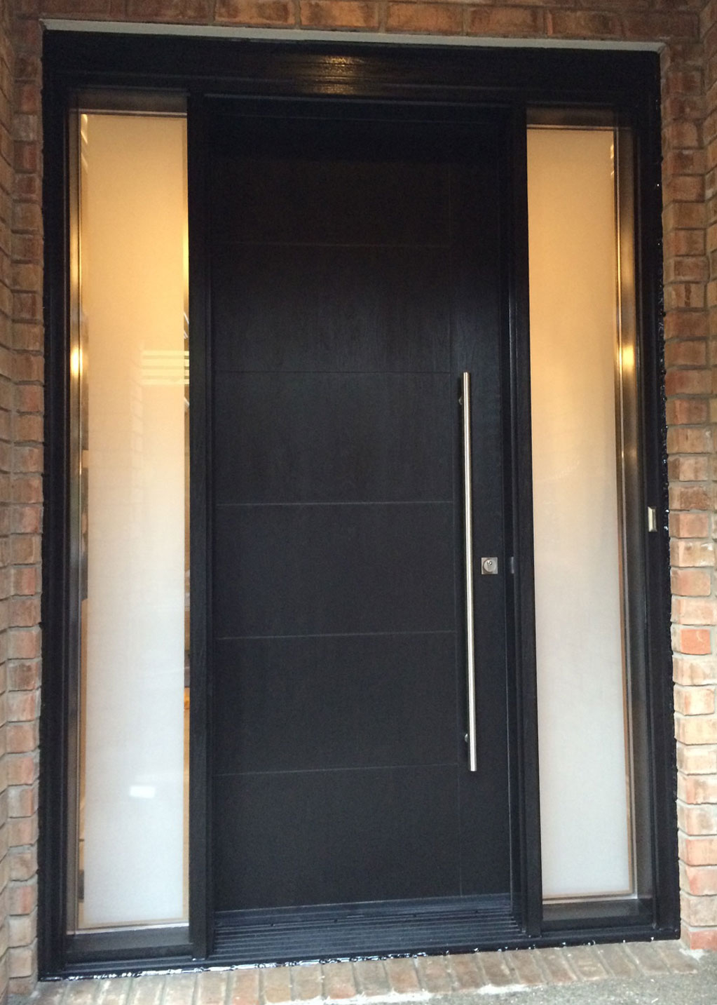 Modern Rustic Woodgrain Fiberglass Entry Door with 2 Frosted Side Lites and Multi Point Locks installed in King City by Modern Doors