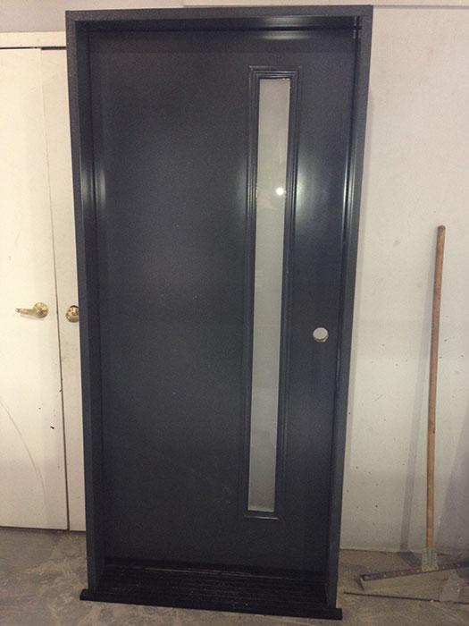 Modern Smooth Front Door-Smooth Door with Door lite-Modern Door with Frosted Door Lite During Manufacturing by modern-doors.ca