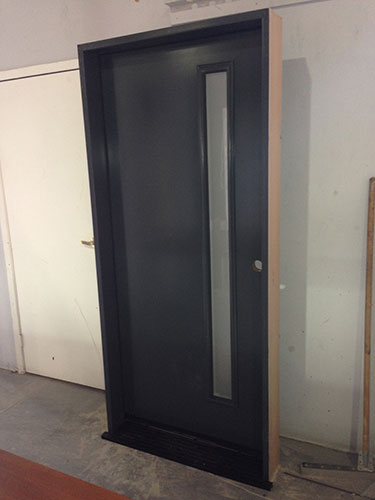 Modern Smooth Front Entry Door-Modern Smooth Door with Door lite-Modern Door with Frosted Door Lite During Manufacturing by modern-doors.ca