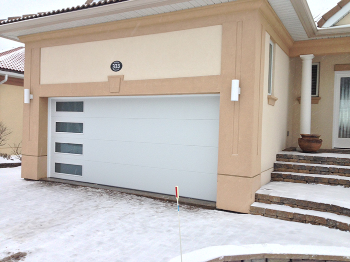 Modern White Garage Door with side lites installed in Midland Ontario