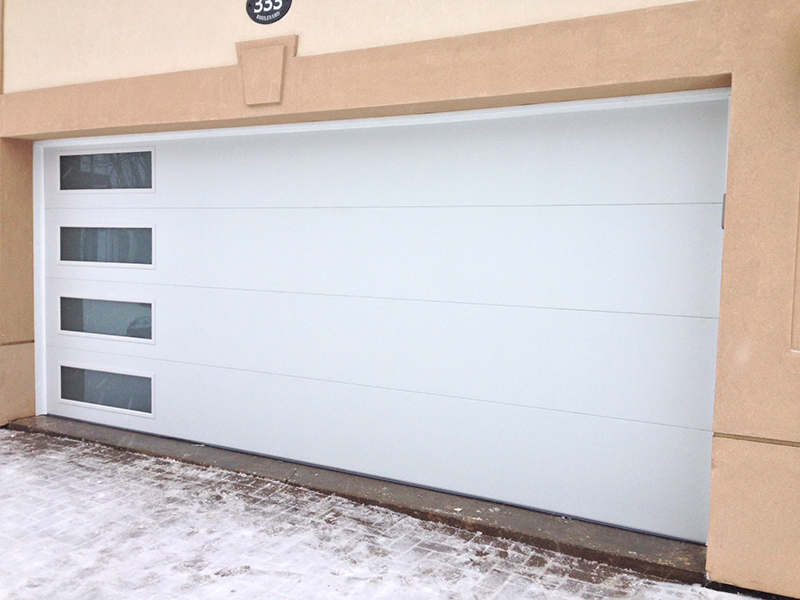 Modern White Garage Door with side lites installed in Midland