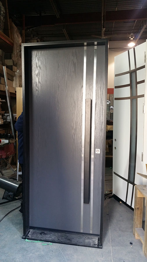 Modern Woodgrain Door with Vertical Stainless Steel Bar and Modern Handle Manufactured by Modern Doors