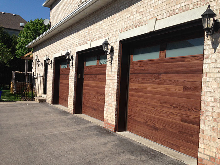 Modern Woodgrain Garage Doors with Frosted Windows Installed by Giant Doors