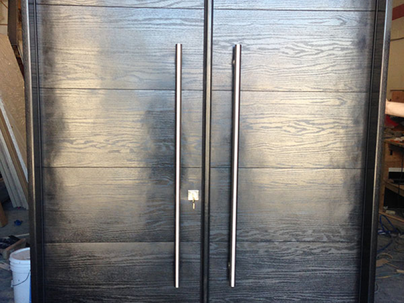 Modern Woodgrain Rustic Doors with Stainless Steel Handles During Manufacturing