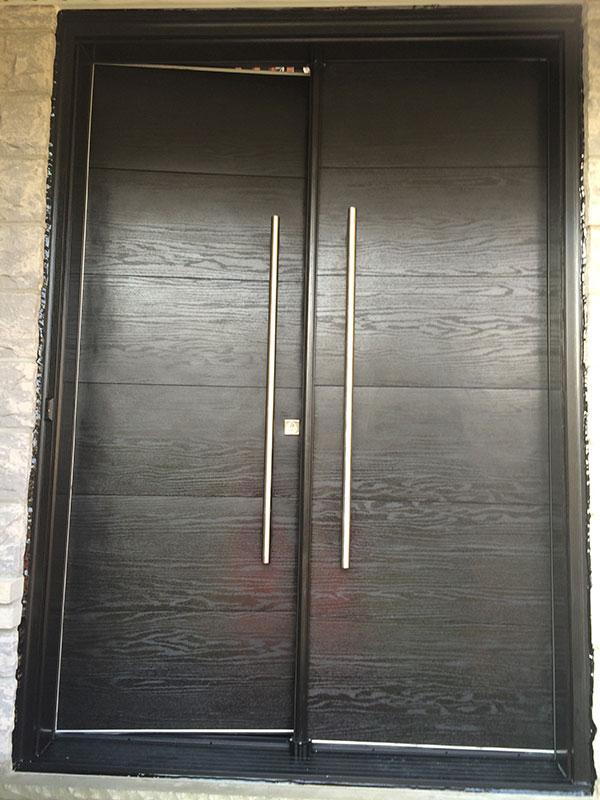 Modern Woodgrain Rustic Doors with Stainless Steel Handles installed in Toronto