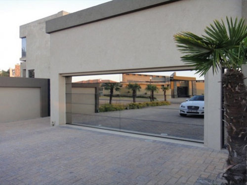 Modern_Garage_Doors_Custom__Aluminum_frame_with_mirror_glazing_full_Privacy.