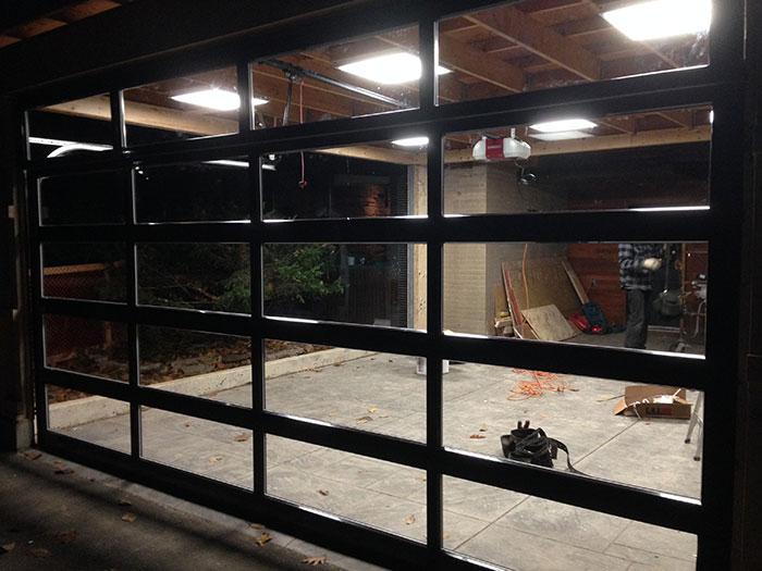 Oversized Aluminum Glass Clear Garage Door Installation in Custom Home in Oakville by Modern Doors